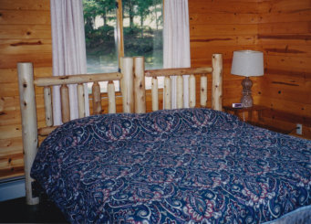 Some of our deluxe cottages have knotty pine interiors and spacious carports.